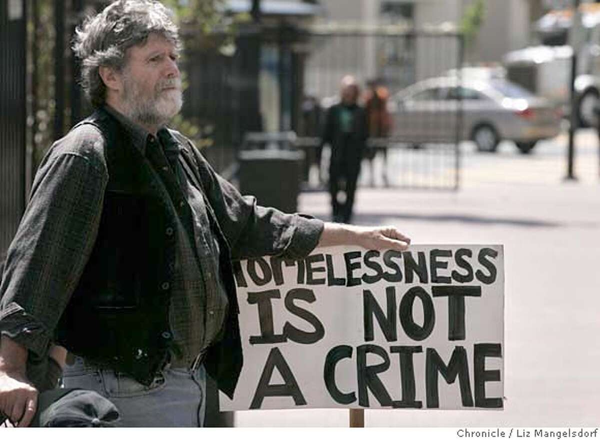 David Grace, from SF, holds a sign as he listens to speeches during a rally and march protesting Mayor Newsom's proposed homeless court on April 24, 2007. This is at Boedeker Park at the end of the march. Liz Mangelsdorf/ The Chronicle ***David Grace (cq)