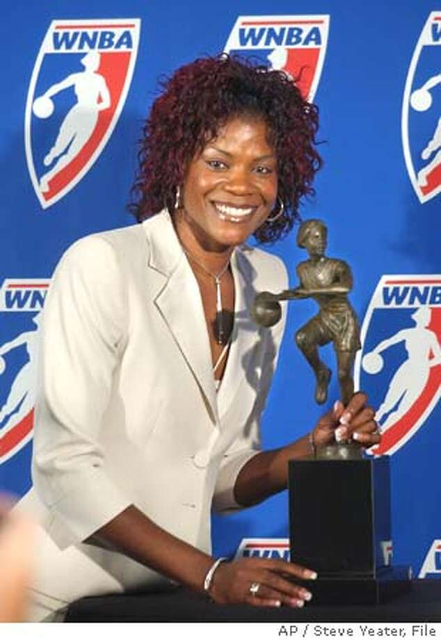 """*** FILE *** Sheryl Swoopes poses with the WNBA Most Valuable Player award after receiving the honor for the third time during a news conference in Sacramento, Calif., Sunday, Sept. 18, 2005. Swoopes is opening up about being a lesbian, telling a magazine that she's """"tired of having to hide my feelings about the person I care about."""" Swoopes, honored last month as the WNBA's Most Valuable Player, told ESPN The Magazine for a story on newsstands Wednesday Oct. 26, 2005 that she didn't always know she was gay and fears that coming out could jeopardize her status as a role model. (AP Photo/Steve Yeater) Photo: STEVE YEATER"""