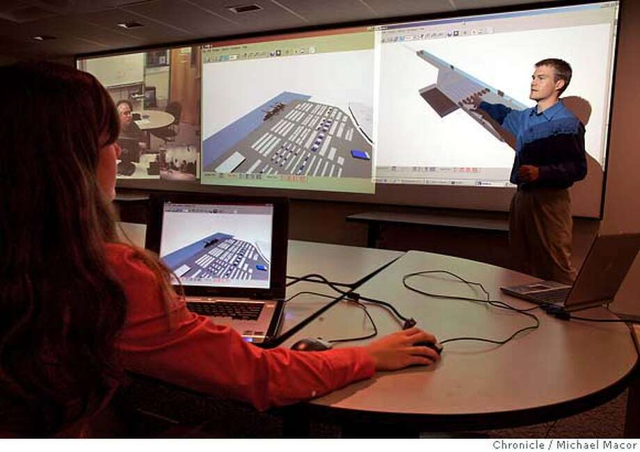 sandia_043_mac.jpg Andy Vaughn, Exploratory Systems Technologies, shows how the program works in a Airport, as well as a Marine Port environment. Technical assistant Bethany McGee, in front. Sandia National Laboratory in Livermore, Ca. has developed a software program the simulates potential terrorist attacks at US Borders, airports and Marine Ports. 10/27/05 Livermore, {state.} Michael Macor / San Francisco Chronicle Mandatory Credit for Photographer and San Francisco Chronicle/ - Magazine Out Photo: Michael Macor