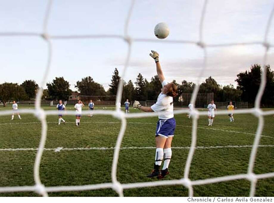 "SOCCER-SCHOLARSHIPS_004_CG.JPG  Lynn Hutchins blocks a shot during practice for the Pleasanton Rage on Wednesday, October 19, 2005. Story is about how hard it is to get a soccer scholarship to college. There are probably many hundreds of kids and their parents in the Bay Area who figure Junior is good enough to get them a break on college tuition at some smart school But the reality is there is very little scholarship money to go around.  As one illustration for the story, we'd like photos of the Pleasanton Rage, a top club team. Group photos of them milling about, playing, whatever, a ""scene"" photo of these 40 scholarship hopefuls working with Cal or Stanford in mind.  Photo by Carlos Avila Gonzalez / The San Francisco Chronicle  Photo taken on 4/7/05 in San Francisco, CA. MANDATORY CREDIT FOR PHOTOG AND SAN FRANCISCO CHRONICLE/ -MAGS OUT Photo: Carlos Avila Gonzalez"