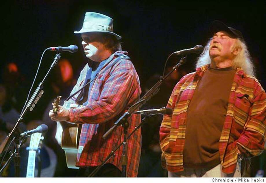 bridge241_mk.JPG  Neil Young and David Crosby sing with Crosby Stills Nash and Young at this year's Bridge School Benefit at the Shoreline Ampitheater.  date} Mike Kepka / The Chronicle MANDATORY CREDIT FOR PHOTOG AND SF CHRONICLE/ -MAGS OUT Photo: Mike Kepka