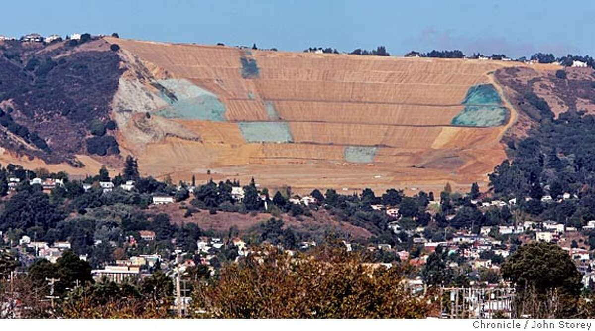 Quarry30 _jrs_0128.jpg The view from the Coliseum Bart station. This is a Real Estate cover story on 400 controversial housing units going in at the old Leona Quarry, that big red slash in the Oakland Hills that you can see from as far away as San Francisco. John Storey Oakland Event on 10/19/05 MANDATORY CREDIT FOR PHOTOG AND SF CHRONICLE/ -MAGS OUT