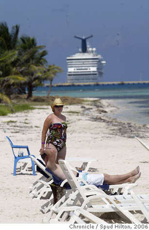 TRAVEL COSTA MAYA -- A cruise ship looms behind tourists at the Tequila Beach Club in Mahahual, a bar and beach that caters to passengers from the nearby cruise port. Mahahual is a tiny fishing village on the southern coast of the Yucatan that is getting busier with the throngs of passengers from the nearby cruise ship pier.  Spud Hilton / The Chronicle Photo: Spud Hilton