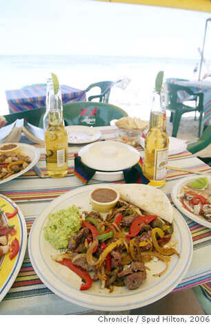 TRAVEL COSTA MAYA -- Steak fajitas and Coronas on the beach in Mahahual. The makeshift bistro is part of the Cat's Meow restaurant, put up on days when a ship is in port Spud Hilton / The Chronicle Photo: Spud Hilton