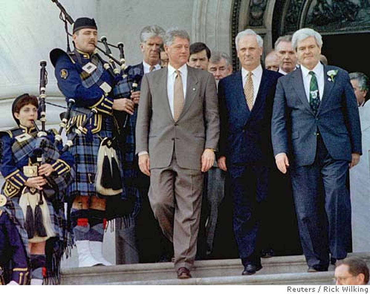 WAS09:IRISH-USA:WASHINGTON,16MAR95- Amid a group of bagpipers, Irish Prime Minister John Bruton (2nd from right) is escorted by U.S. President Clinton (C) and House Speaker Newt Gingrich, (R),R-GA, after the leaders attended a pre-St. Patrick's Day luncheon together March 16 at the U.S. Capitol. Bruton is scheduled to attend an American-Ireland Fund dinner later in the day with Sinn Fein leader Gerry Adams. sv/Rick Wilking REUTER CAT
