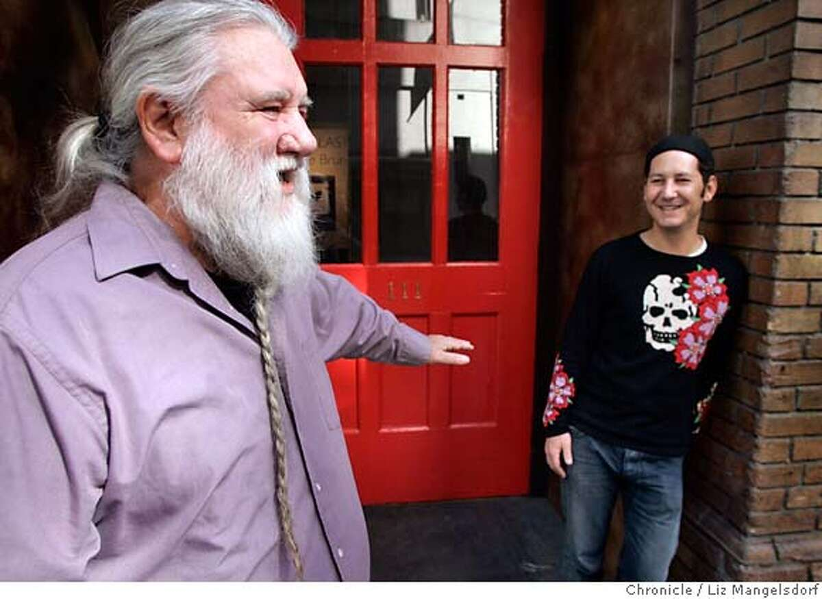 Ron Turner, left, in front of the big red door at the entrance to the Minna Gallery, at 111 Minna in San Francisco. With him is Minna Gallery owner Eiming Jung. Photographed on Feb. 20, 2007 . Photo by Liz Mangelsdorf/ San Francisco Chronicle ***Eiming Jung, Ron Turner (CQ)