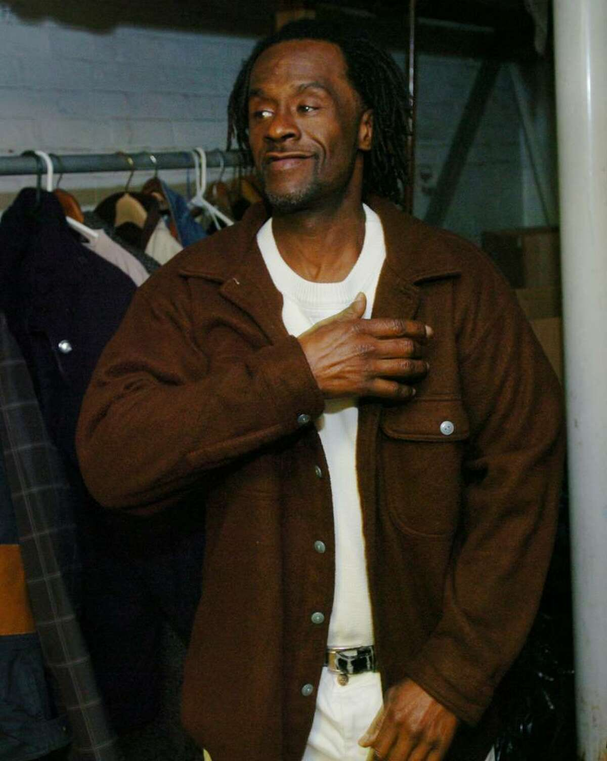 Dennis Boyd of Bridgeport tries on a coat at the Bridgeport Rescue Mission at 1088 Fairfield Avenue in Bridgeport recently.
