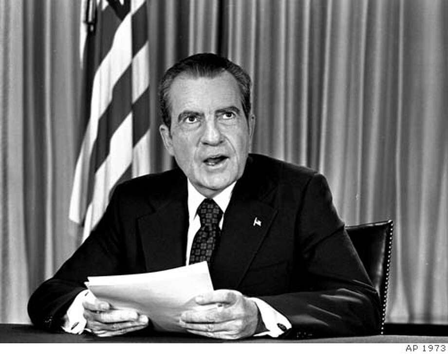 President Nixon sits in his White House office, August 16, 1973, as he poses for pictures after delivering a nationwide television address dealing with Watergate. Nixon repeated that he had no prior knowledge of the Watergate break-in and was not aware of any cover-up. (AP Photo/stf) Ran on: 08-08-2004  Then-President Richard Nixon and his secretary of state, Henry Kissinger, met on the porch of the White House in 1972. Ran on: 08-08-2004  Then-President Richard Nixon and his secretary of state, Henry Kissinger, met on the porch of the White House in 1972. Photo: Ap