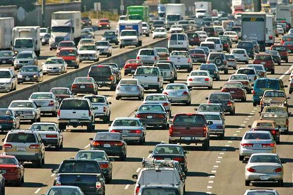 justlikela_006_mac.jpg Afternoon traffic along I-880 freeway through Oakland btween Davis St. and Marina. A new study says that traffic in the San Francisco Bay Area � now with the nation�s third-worst traffic � will be as bad in 2030 as Los Angeles is now. the report, funded by the Reason Foundation, comes up with possible solutions for every U.S. state. In California, the group says, more than 13,000 lane miles must e added before 2030 to keep up with population growth � and about 3,000 of those miles should be built in the Bay Area. That would cost $122 billion � or more than $139 per resident per year. But building those needed lanes will save 1.8 million hours that would otherwise be spent sitting in traffic, according to the study. Event in, Oakland, Ca, on 8/30/06. Photo by: Michael Macor/San Francisco Chronicle  Ran on: 08-31-2006  Afternoon traffic along I-880 in Oakland is bad -- and will get worse, according to a libertarian think tank, unless the highway system is expanded.  Ran on: 08-31-2006  Oakland's Mark Ellis dives for a ground ball.  Ran on: 08-31-2006 Ran on: 08-31-2006  Afternoon traffic along I-880 in Oakland is bad -- and will get worse, according to a libertarian think tank, unless the highway system is expanded.  Ran on: 11-05-2006  Traffic congestion on I-880 and other freeways won't be remedied by a measly $20 billion in state transportation bonds. Mandatory credit for Photographer and San Francisco Chronicle No sales/ Magazines Out
