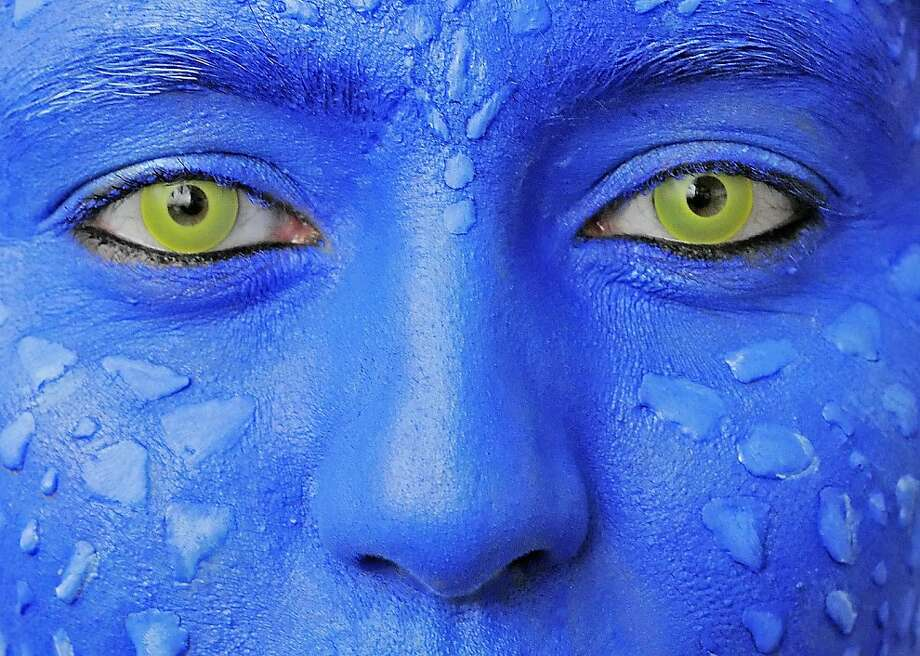 Avatar eyes: A face painter watches the cosplay Manga competition during the International Leipzig Book Fair in Germany. Photo: Jens Meyer, Associated Press