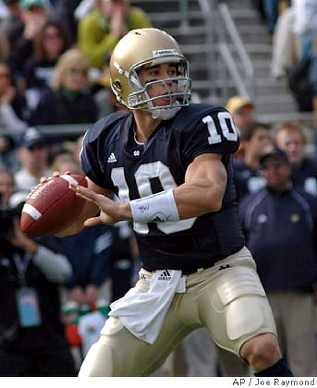 ** FILE ** Notre Dame quarterback Brady Quinn (10) throws a pass during the first quarter of Notre Dame's 20-17 victory over UCLA in college football action Saturday Oct. 21, 2006 in South Bend, Ind. (AP Photo/Joe Raymond)