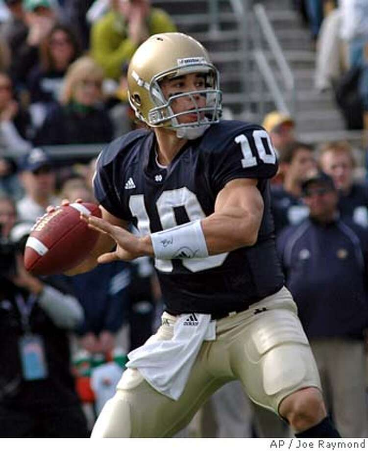 ** FILE ** Notre Dame quarterback Brady Quinn (10) throws a pass during the first quarter of Notre Dame's 20-17 victory over UCLA in college football action Saturday Oct. 21, 2006 in South Bend, Ind. (AP Photo/Joe Raymond) Photo: JOE RAYMOND
