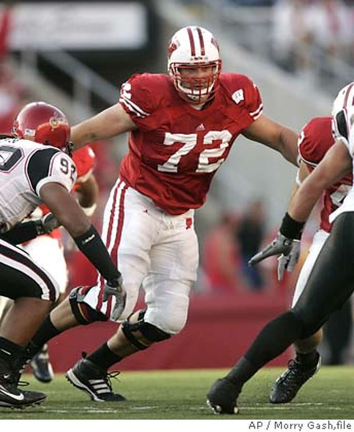 ** FILE ** Wisconsin offensive lineman Joe Thomas (72) looks to block during the second half of a football game against San Diego State Saturday, Sept. 16, 2006, in Madison, Wisc. (AP Photo/ Morry Gash,file) FOR USE AS DESIRED WITH NFL DRAFT STORIES. SEPT. 16, 2006 FILE PHOTO. EFE OUT