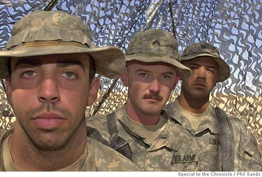 Sergeant Erik Howard (centre) Private Kevin Clark (right) and Jeremy Engelmann (left), a team of line medics, have responded to six bomb explosions in the last two months, with 14 soliders from their unit, C Troop of the 4/14 Cavalry, injured, six requiring helicopter evacuation.  Photo by Phil Sands, 25th Oct 2005 Photo: Phil Sands