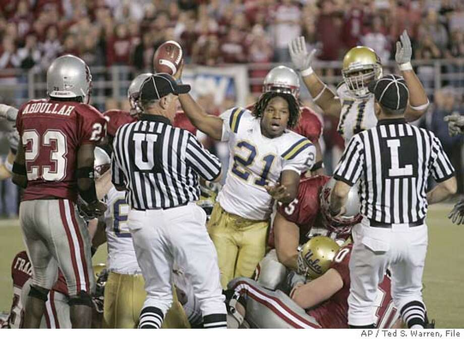 UCLA tailback Maurice Drew (21) celebrates his overtime touchdown against Washington State Saturday, Oct. 15, 2005 at Martin Stadium in Pullman, Wash. The touchdown gave UCLA a 44-41 win over Washington State in overtime. (AP Photo/Ted S. Warren) Photo: TED S. WARREN