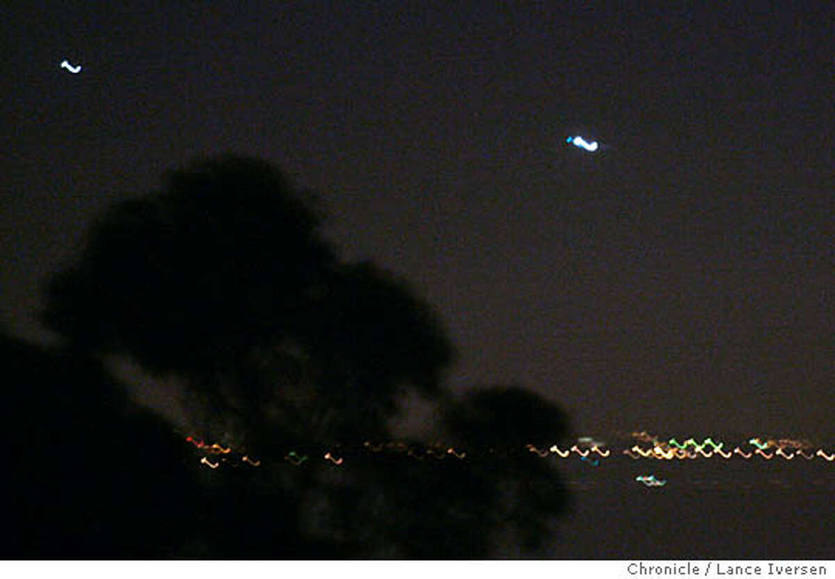 UFO_0027 Unidentified lights appear to hover over San Francisco Bay north of the San Francisco Airport late Wednesday night. The lights on the bottom of the photo are from the East Bay and are blurred do to a slow shutter speed of the camera. By Lance Iversen/San Francisco Chronicle