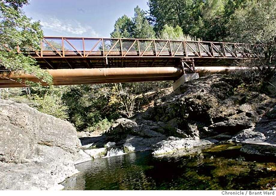 trail734_ward.jpg  The new Inkwells bridge just west of Lagunitas is 170 feet long across the Cross Marin trail. It was designed for horses as well as hikers...it leads travelers to Samuel P. Taylor State park.10/25/05 Photo: Brant Ward