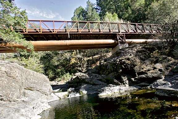 trail734_ward.jpg  The new Inkwells bridge just west of Lagunitas is 170 feet long across the Cross Marin trail. It was designed for horses as well as hikers...it leads travelers to Samuel P. Taylor State park.10/25/05