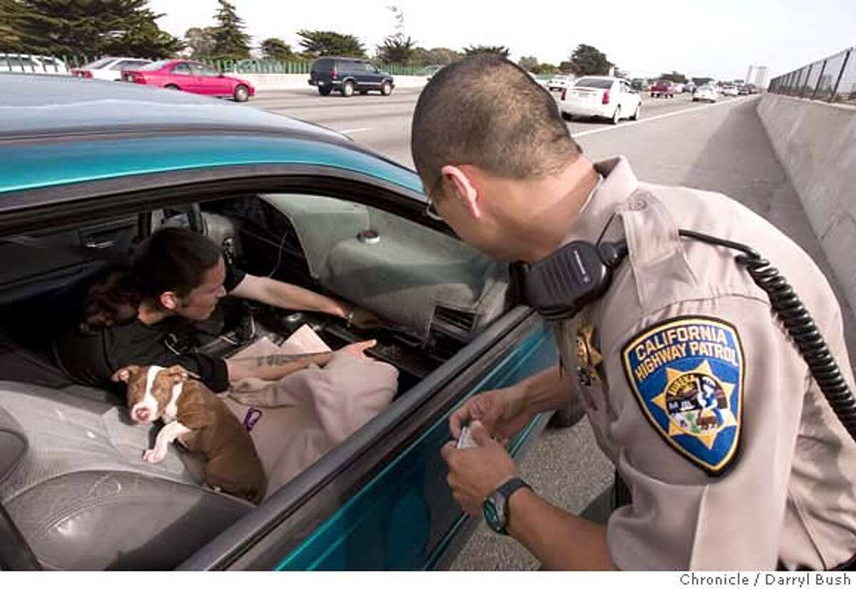 carpoollanes_0004_db.JPG CHP officer Tony Yao cites a carpool violator as the violator looks for his registration with his puppy in the front seat of his car on pulled over Westbound on Highway 80 in Berkeley, CA, on Wednesday, April, 25, 2007. photo taken: 4/25/07 Darryl Bush / The Chronicle ** (cq) MANDATORY CREDIT FOR PHOTOG AND SF CHRONICLE/NO SALES-MAGS OUT