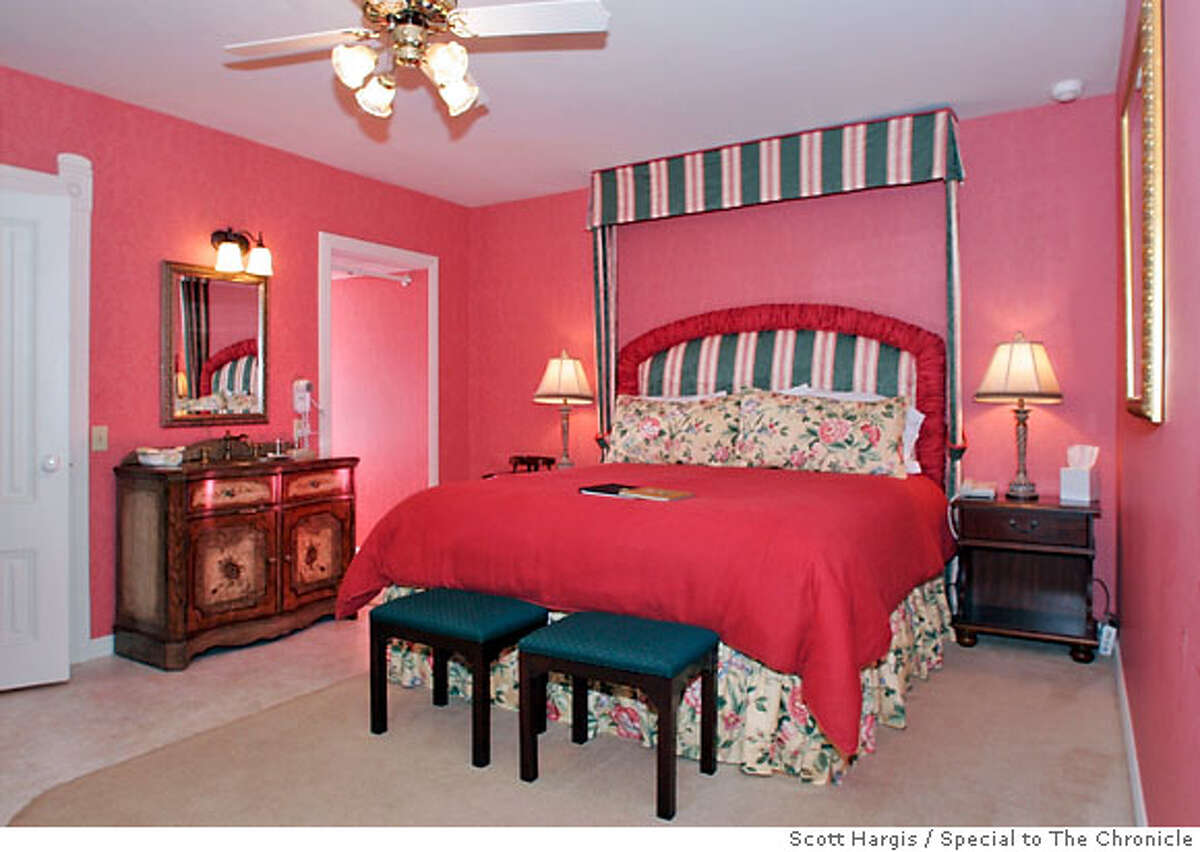 Guest room at the Hopland Inn furnished with victorian-style furniture and baths