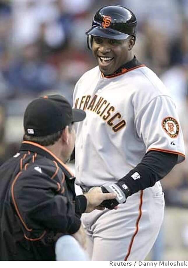 San Francisco Giants Barry Bonds (R) is congratulated by manager Bruce Bochy as he comes into the dugout after hitting a three run home run to center field against the Los Angeles Dodgers during the first inning of their National League MLB baseball game in Los Angeles, April 25, 2007. REUTERS/Danny Moloshok (UNITED STATES)  Ran on: 04-26-2007  Barry Bonds is congratulated by manager Bruce Bochy after hitting a three-run home run in the first inning. Photo: DANNY MOLOSHOK