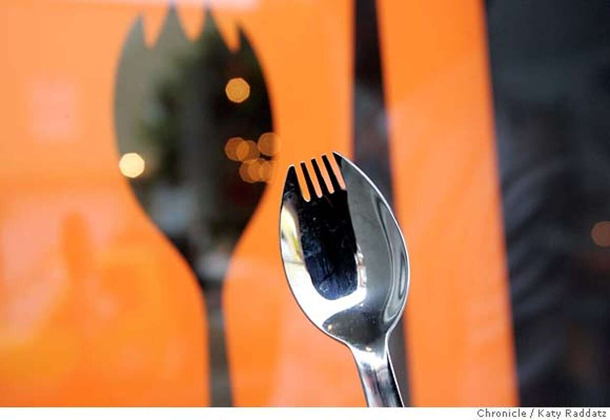 WHATSNEW25_025_RAD.jpg SHOWN: An actual spork, held in front of the restaurant's front door. Spork is the name of this new restaurant at 1058 Valencia, where a Kentucky Fried Chicken once stood. A fun historical note: KFC invented the spork, which is a combo of fork and spoon--chef Bruce Binn carries a spork in his pocket for good luck. These pictures were made in San Francisco, CA. on Thursday, April 19, 2007. (Katy Raddatz/The Chronicle) **Bruce Binn, spork Mandatory credit for the photographer and the San Francisco Chronicle. No sales; mags out.