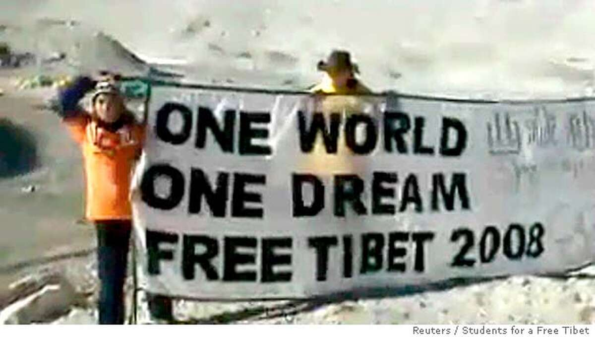 Activists Tenzin Dorjee (L) and Mac Sutherlin hold a banner at Mount Everest's base camp in Tibet April 25, 2007. China detained four U.S. citizens, including Dorjee and Sutherlin, demonstrating for a free Tibet and protesting the Beijing Olympics at the base of Mount Everest, an overseas activist group, Students for a Free Tibet, said on Wednesday. China's Foreign Ministry had no immediate comment, while nobody answered the telephone at the Tibet government's information office in Lhasa. QUALITY FROM SOURCE REUTERS/Students for a Free Tibet/Shannon Service/Handout (CHINA). EDITORIAL USE ONLY. NOT FOR SALE FOR MARKETING OR ADVERTISING CAMPAIGNS. NO SALES. NO ARCHIVES.