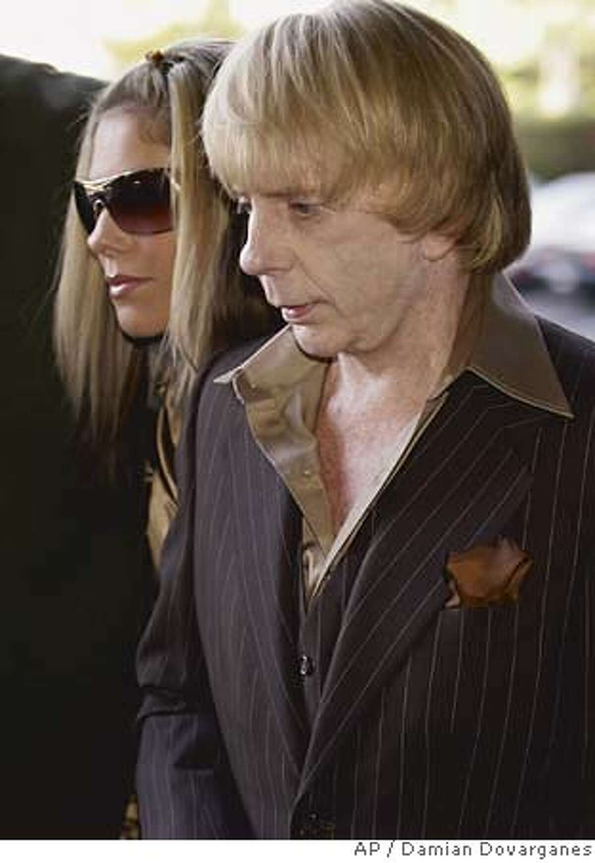 Music producer Phil Spector, right, arrives with his wife Rachelle Spector, at Los Angeles Superior Court, Tuesday April 24, 2007 in Los Angeles, during jury selection proceeding in his murder trial. (AP Photo/Damian Dovarganes)