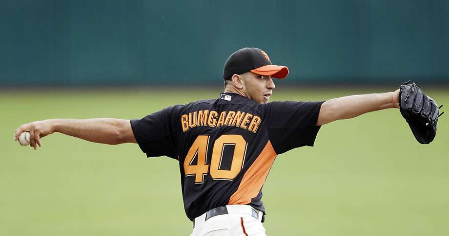 San Francisco Giants starting pitcher Madison Bumgarner throws to the San Diego Padres during the second inning of a spring training baseball game, Sunday, March 18, 2012, in Scottsdale, Ariz. (AP Photo/Marcio Jose Sanchez) Photo: Marcio Jose Sanchez, Associated Press