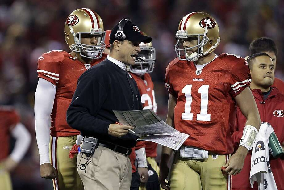 FILE - In this Dec. 19, 2011 file photo, San Francisco 49ers head coach Jim Harbaugh, center, talks with quarterback Alex Smith (11) during the second quarter of an NFL football game against the Pittsburgh Steelers in San Francisco. In the Bay Area, they're beginning to think about the possibility of Jim Harbaugh coaching former Indianapolis Colts quarterback Peyton Manning and believe it truly might happen. 49ers free agent quarterback Alex Smith traveled to Miami Sunday, March 18, 2012, to meet with the Dolphins. But if San Francisco doesn't sign Manning the 49ers will have some serious relationship-building to do with Smith. (AP Photo/Paul Sakuma, File) Photo: Paul Sakuma, Associated Press