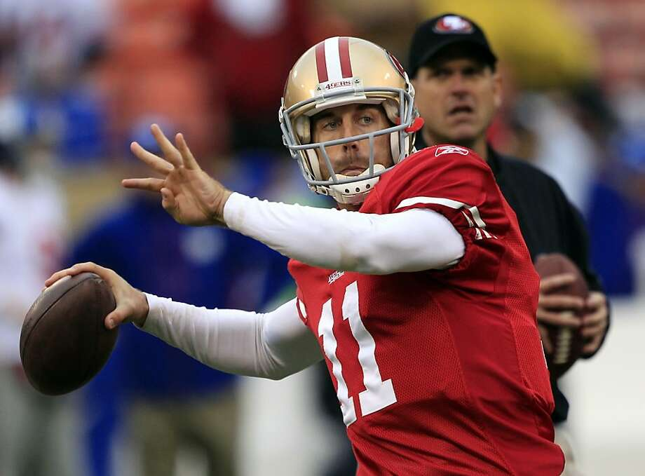 FILE - In this Jan. 22, 2012 file photo, San Francisco 49ers quarterback Alex Smith (11) warms up as head coach Jim Harbaugh watches before the NFC Championship NFL football game against the New York Giants, in San Francisco. Smith, a free agent quarterback, will visit with the Miami Dolphins, said a person familiar with the move, according to The Associated Press, Sunday, March 18, 2012. The person spoke to The Associated Press on condition of anonymity because the team has not announced Sunday's meeting. (AP Photo/Marcio Sanchez, File) Photo: Marcio Sanchez, Associated Press