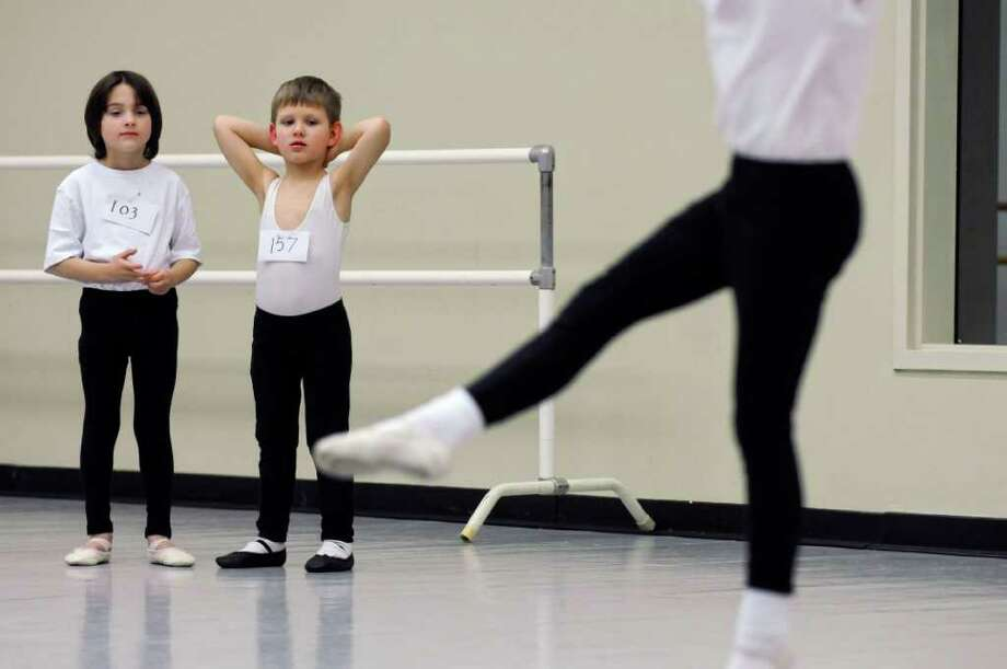 John Zorbas of Colonie, 6, left, and Owen Gerry of Schenectady, 5, right, await their turn during an audition for children for the upcoming New York City Ballet performances of Firebird and Romeo + Juliet this summer at SPAC, as the National Museum of Dance on Sunday March 18, 2012 in Saratoga Springs, N.Y. About 200 young dancers tried out. (Philip Kamrass / Times Union ) Photo: Philip Kamrass / 00016468A
