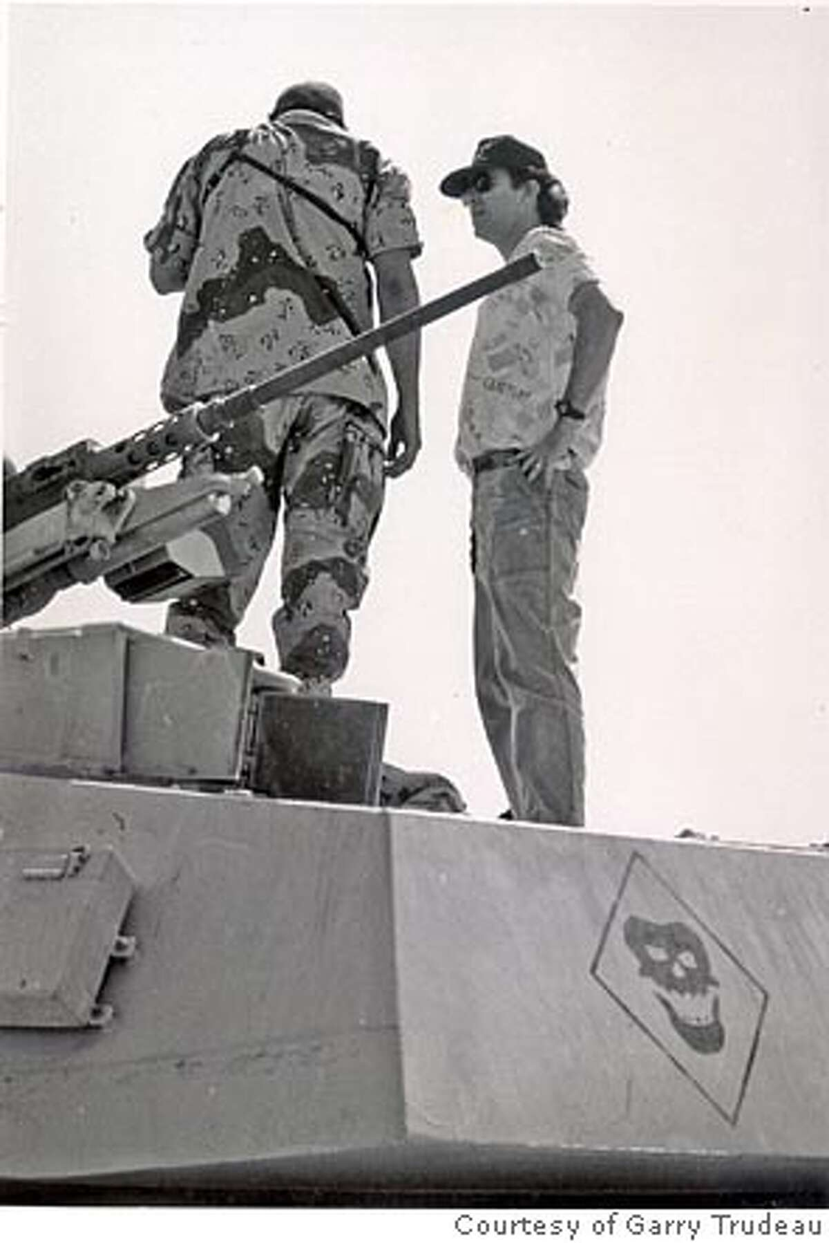 Camp Thunder Rock, Spring 1991. Being briefed on capabilities of a Bradley Fighting Vehicle by its commander.