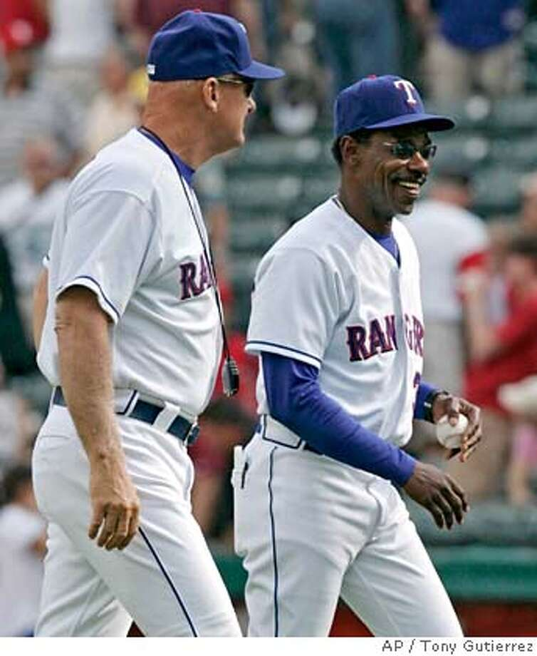 Texas Rangers manager Ron Washington, right, smiles as he walks off the field with bench coach Art Howe following their 4-3 win over the Oakland Athletics in a baseball game in Arlington, Texas, Sunday, April 22, 2007. (AP Photo/Tony Gutierrez) Photo: Tony Gutierrez