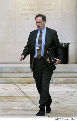 Special Counsel Patrick Fitzgerald leaves the U.S. District Court after Karl Rove testified before the grand jury on Friday, Oct. 14, 2005, in Washington. Rove testified for the fourth time Friday before the grand jury in the CIA leak probe, following public disclosure of his conversations with two reporters about the identity of a covert officer at the spy agency. (AP Photo/Kevin Wolf) Photo: KEVIN WOLF