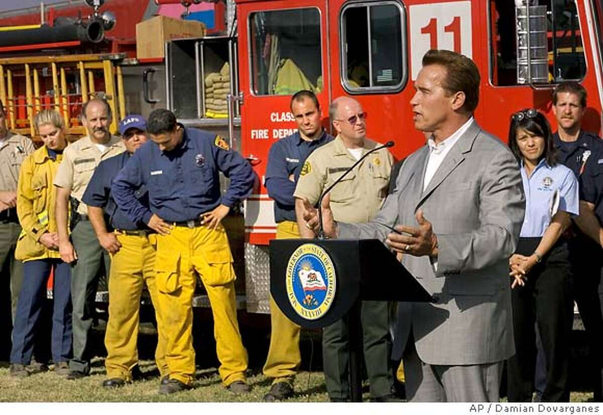 ** FILE **California Gov. Arnold Schwarzenegger declines to comment on Proposition 75, as he thanks firefighters and law enforcement officials for their work controlling the Southern California brush fires in this file photo taken Sept. 30, 2005, in Thousand Oaks, Calif. Proposition 75, called