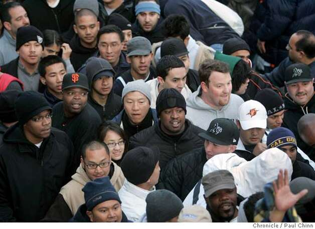 Basketball fans jam together trying to form a line to buy Golden State Warriors tickets for the first round series against the Dallas Mavericks at the Oracle Arena in Oakland, Calif. on Saturday, April 21, 2007. About 2,500 tickets were available for Games 3 and 4. Some fans camped outside the parking lot as early as Friday night.  PAUL CHINN/The Chronicle Photo: PAUL CHINN