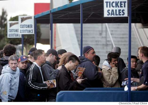 Fans lined up early to buy Golden State Warriors tickets for the first round series against the Dallas Mavericks at the Oracle Arena in Oakland, Calif. on Saturday, April 21, 2007. About 2,500 tickets were available for Games 3 and 4. Some fans camped outside the parking lot as early as Friday night.  PAUL CHINN/The Chronicle Photo: PAUL CHINN
