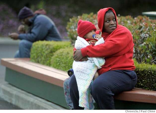Shannon Dale of San Jose keeps warm with Jaylen while her husband waited in line to buy Golden State Warriors tickets for the first round series against the Dallas Mavericks at the Oracle Arena in Oakland, Calif. on Saturday, April 21, 2007. About 2,500 tickets were available for Games 3 and 4. Some fans camped outside the parking lot as early as Friday night.  PAUL CHINN/The Chronicle  **Shannon Dale, Jaylen Photo: PAUL CHINN