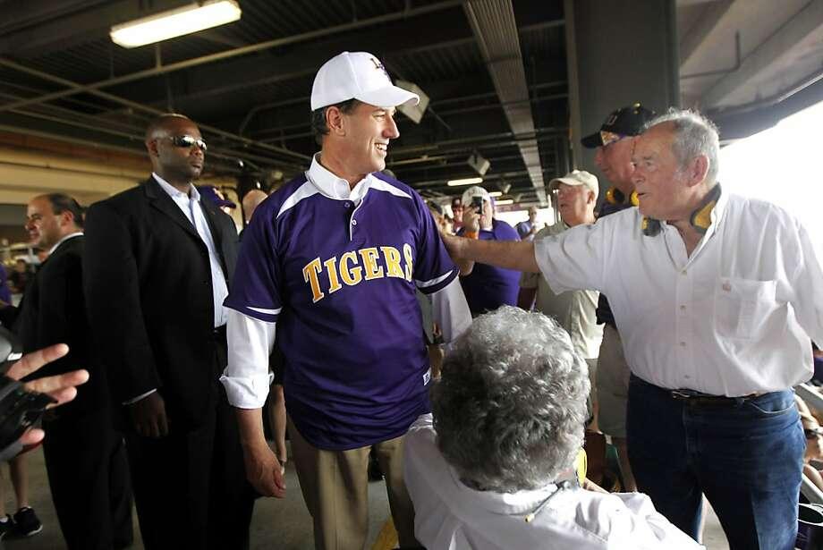 Republican presidential candidate, former Pennsylvania Sen. Rick Santorum, greets LSU fans at the LSU vs. Mississippi State NCAA college baseball game at Alex Box Stadium in Baton Rouge, La., Sunday, March 18, 2012. (AP Photo/Gerald Herbert) Photo: Gerald Herbert, Associated Press