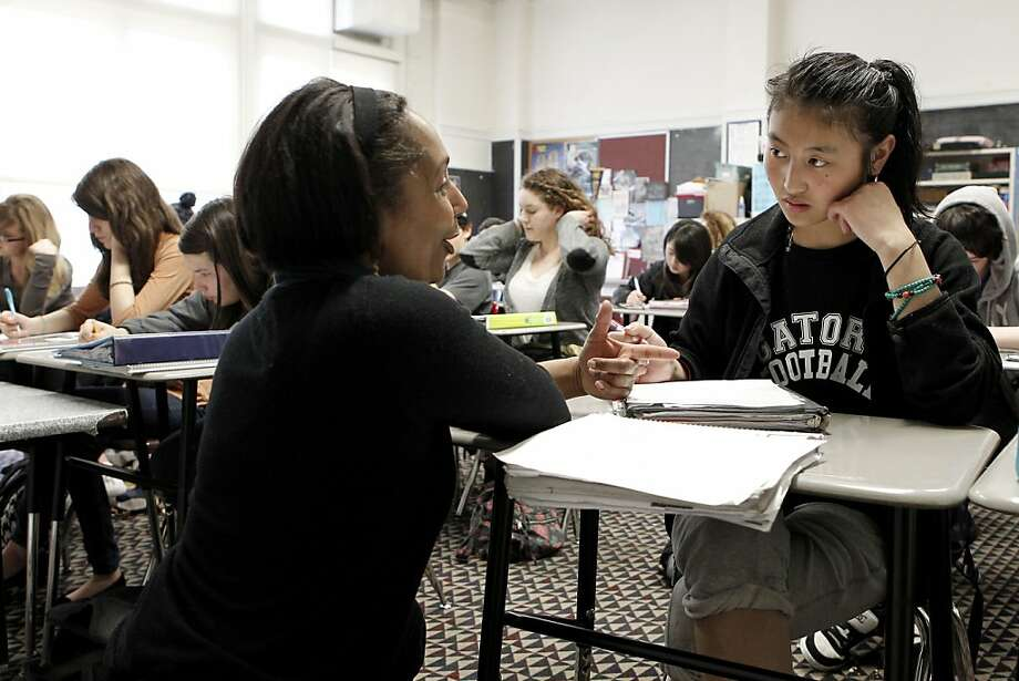 Instructor, Angela Grimes helps out student, Tasi Lama during ninth grade seminar, on Friday March 16, 2012, at Gateway High School in San Francisco, Ca. Gateway High School received a grant a few years back to create a ninth grade seminar to help prevents dropouts, teaching students skills in note taking, organization and health and nutrition issues. AT&T is expanding the grant program across the country, adding $225 million. Photo: Michael Macor, SFC