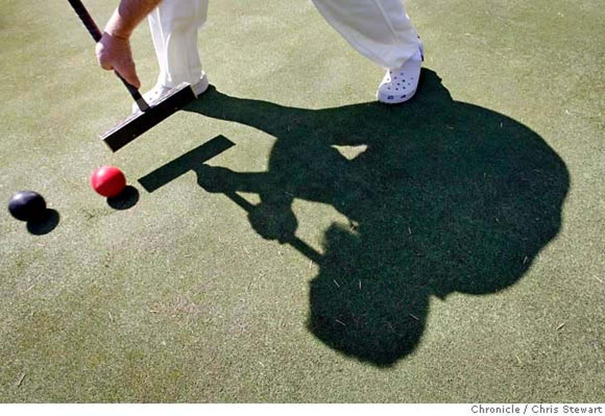 croquet_176_cs.jpg Jerry Stark's mallet drives croquet balls towards the next wicket on the Meadowood croquet court in St. Helena. Jerry Stark (cq), 52, is ranked number two in the nation as a competitive croquet player and the croquet director at Meadowood in St. Helena. Photographed March 21, 2007. Chris Stewart / The Chronicle Jerry Stark, croquet, Meadowood MANDATORY CREDIT FOR PHOTOG AND SF CHRONICLE/NO SALES-MAGS OUT