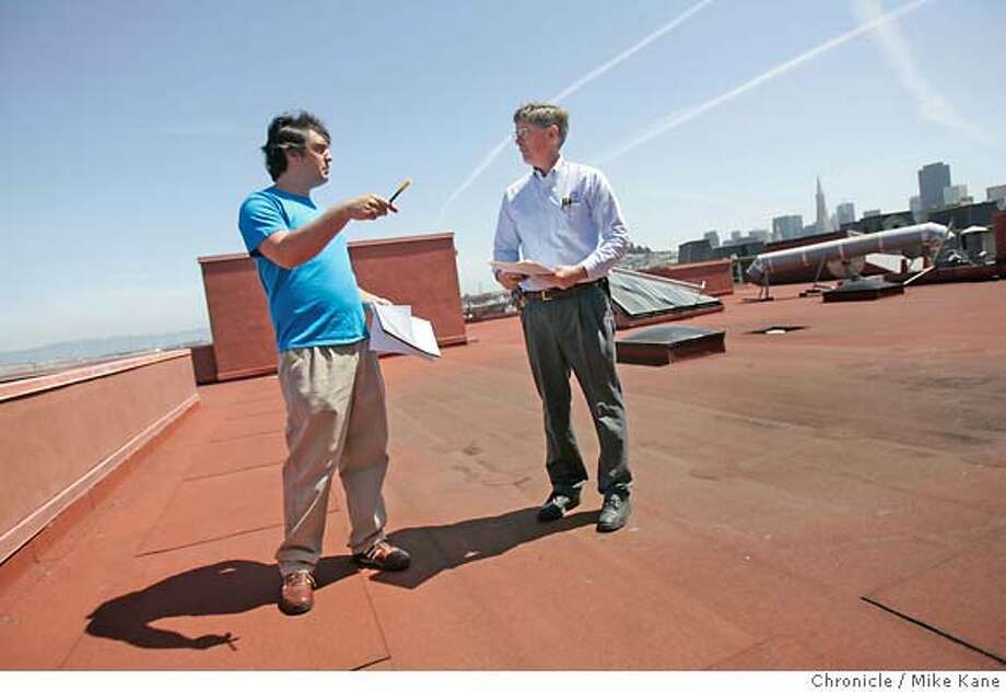 "GREEN_WORK_02.jpg  Pacific Gas and Electric Company business customer representative David Gutierrez, left, performs an energy audit with Richard Rockwood, Chief Engineer with VNO Patson, on the roof of the Cannery in San Francisco, CA, on Friday, April, 13, 2007. Cannery property managers plan on replacing their boilers and contacted PG&E to look into rebates offered for ""going green."" photo taken: 4/13/07  Mike Kane / The Chronicle **David Gutierrez, Richard Rockwood Photo: MIKE KANE"