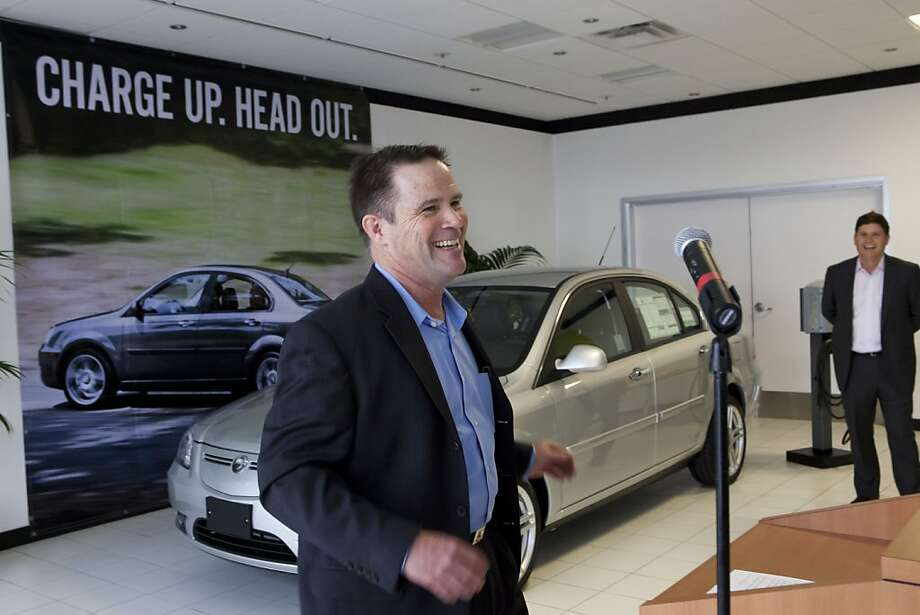 Randy Abraham, of Redwood City, shows his excitement and enthusiasm for being the first to purchase a Coda vehicle from the dealership during the grand opening ceremony on Friday, March 16, 2012 in Santa Clara, Calif. Photo: John Sebastian Russo, Special To The Chronicle