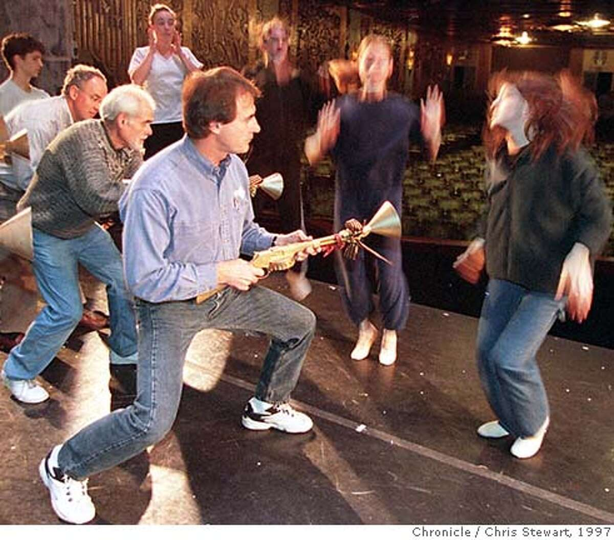 St. Louis Cardinals coach Tony La Russa (C), Oakland A's broadcaster Bill King (left of La Russa) and A's president San Alderson (L) joined other celebrities to perform in the 1997 All-Star Night at The Nutcracker with the Oakland Ballet. Here they rehearse as tin soldiers firing upon mice soldiers for the December 19th performance. SAN FRANCISCO CHRONICLE PHOTO BY CHRIS STEWART