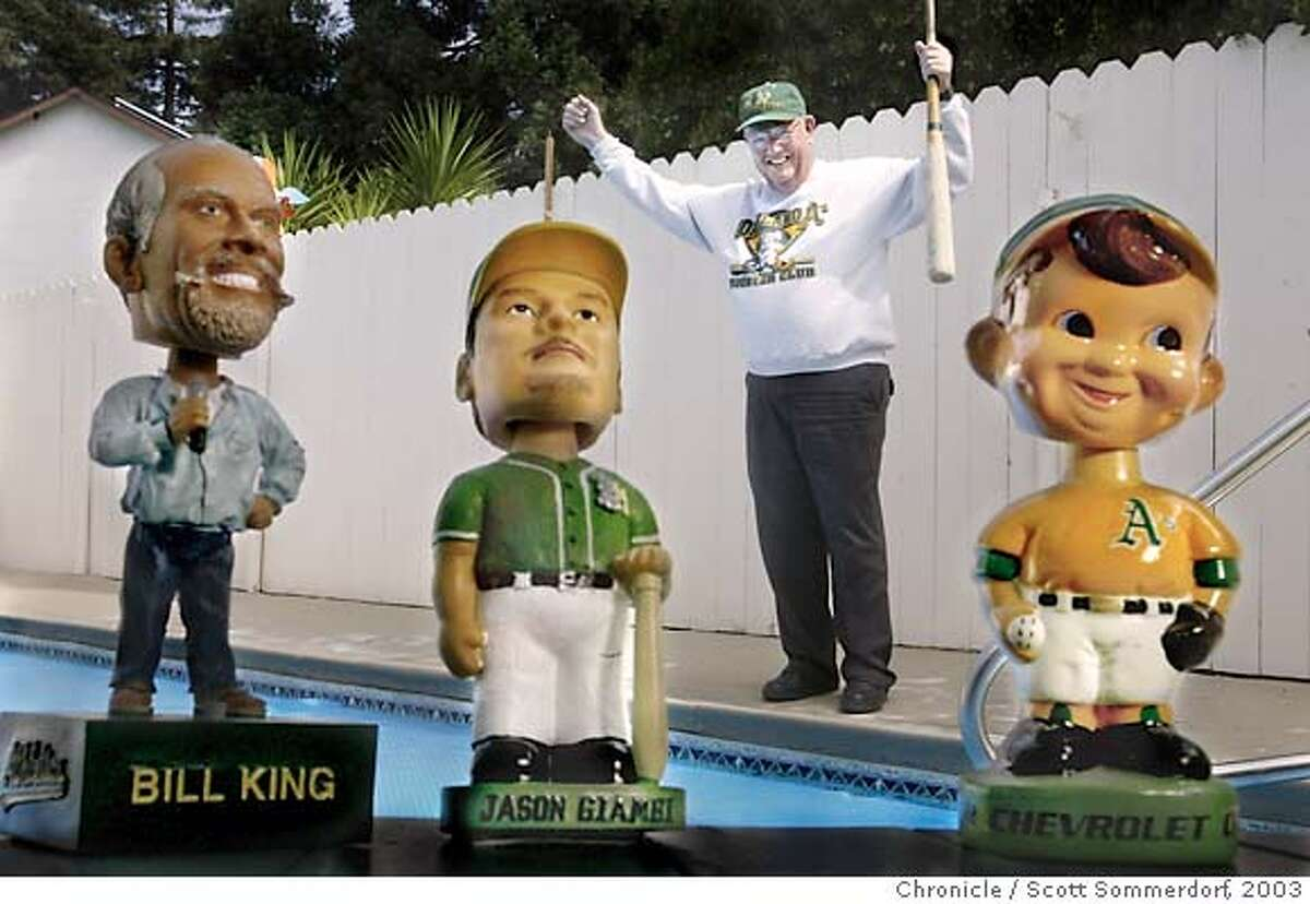 oaklandfan_01_ss ----- Don Murphy is a longtime A's fan, a season ticket holder from the very first season in Oakland in 1968. Here he is pictured posing behind three A's bobbleheads at his home in Hayward. The bobbleheads are from left: Announcer Bill King, Jason Giambi as a Modesto A, and a very old A's bobblehead. SF CHRONICLE PHOTO BY SCOTT SOMMERDORF