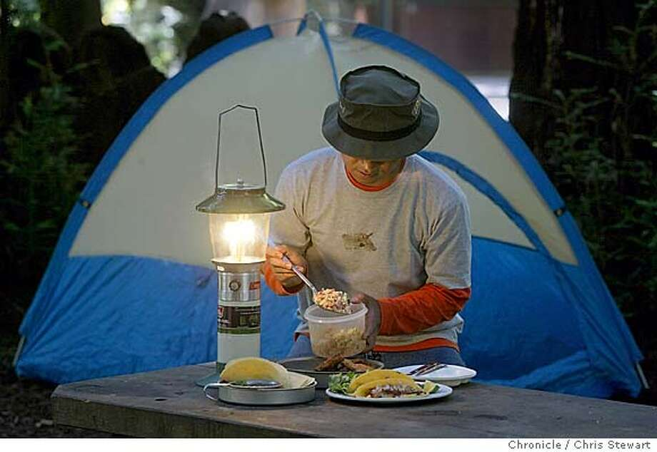 7/23/03 | Color |  |  |  | Food | AZ 8442 | camping230299_cs.jpg Photo: CHRIS STEWART