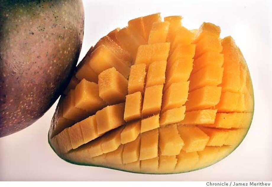 ... 5.8-ounces of raw mango (99 calories). Photo: JIM MERITHEW