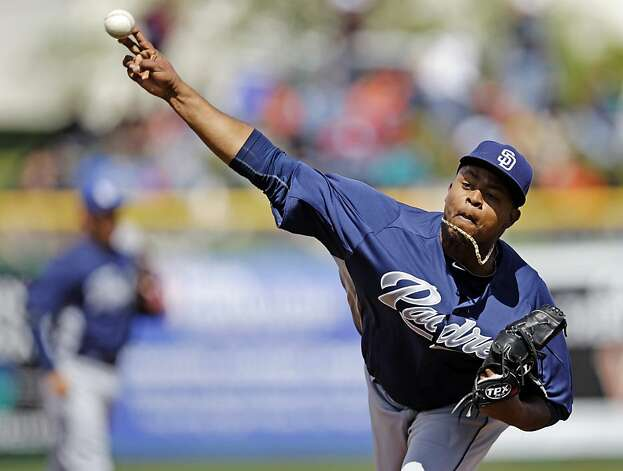 San Diego Padres starting pitcher Edinson Volquez throws to the San Francisco Giants during the first inning of a spring training baseball game, Sunday, March 18, 2012, in Scottsdale, Ariz. (AP Photo/Marcio Jose Sanchez) Photo: Marcio Jose Sanchez, Associated Press