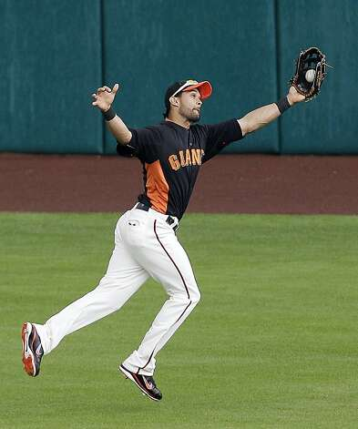 San Francisco Giants center fielder Angel Pagan makes a leaping grab on a line drive from San Diego Padres' Chase Headley during the fourth inning of a spring training baseball game, Sunday, March 18, 2012, in Scottsdale, Ariz. (AP Photo/Marcio Jose Sanchez) Photo: Marcio Jose Sanchez, Associated Press